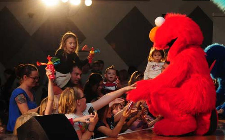 Sesame Street Star Elmo greets fans at the end of The Sesame Street/USO Experience at the Community Center aboard Camp Foster Tuesday. The show is currently on tour throughout the Pacific with the last Okinawa show taking place Feb. 3 on Camp Courtney. The tour then moves to Korea and then Guam.
