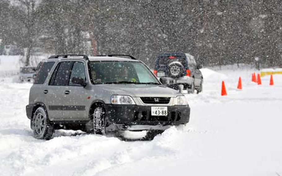 """Alyssa Craig, 17, slides around a snowy curve during the first """"Slippery Weasel"""" winter safety driver's course Jan. 15 at Misawa Air Base in northern Japan."""