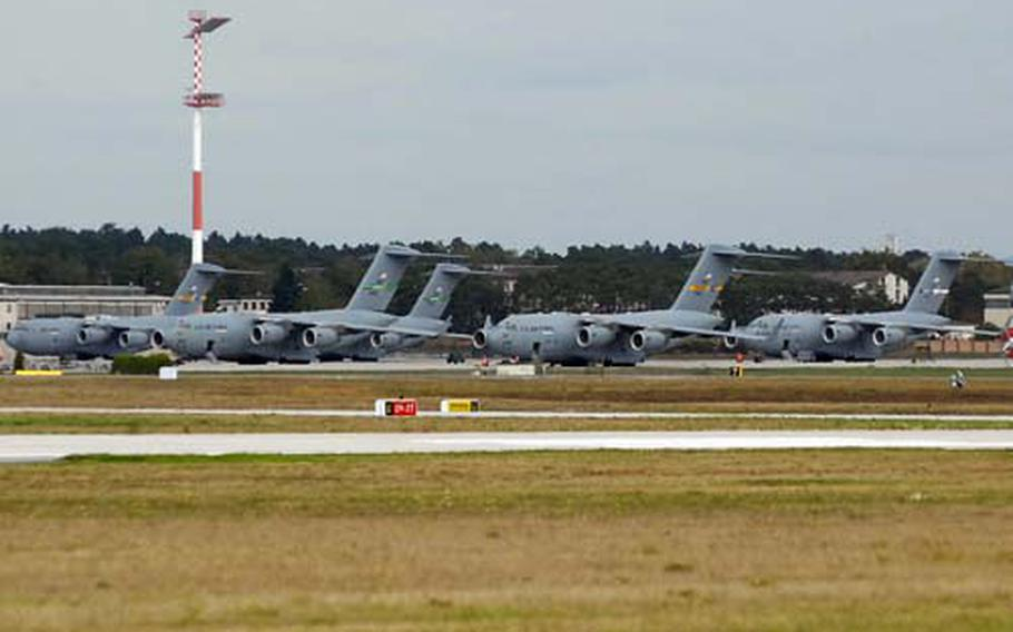 A flock of C-17 Globemaster IIIs sits on the flight line at Ramstein Air Base, Germany. Ramstein and Air Base will see an increase in heavy-lift operations starting in early February, due to the troop increases in Afghanistan.