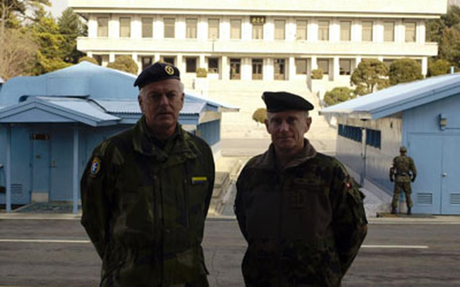 Swedish Maj. Gen. Christer Lidstrom, left, and Swiss Maj. Gen. Jean-Jacques Joss, of the Neutral Nations Supervisory Commission, stand on the South Korea side of the Joint Security Area of the Demilitarized Zone on Jan. 24. They continue to lead five-member delegations from their countries in compliance with the armistice that ended Korean War hostilities in 1953.