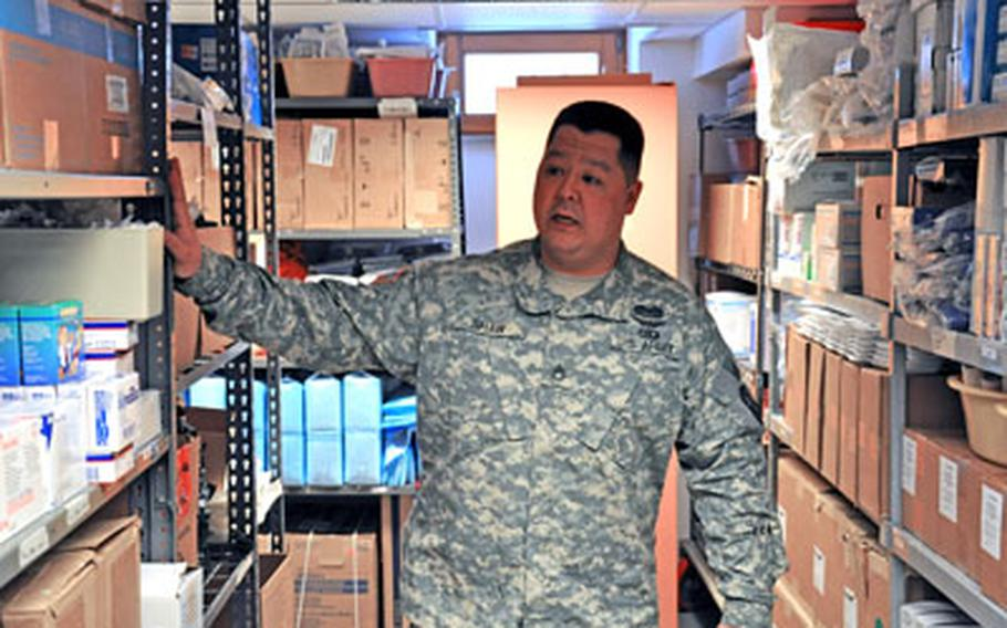 Staff Sgt. Michael Shaw gives a tour through the aid station supply room located in Warner Barracks in Bamberg, Germany. Shaw is a pharmacy noncommissioned officer.