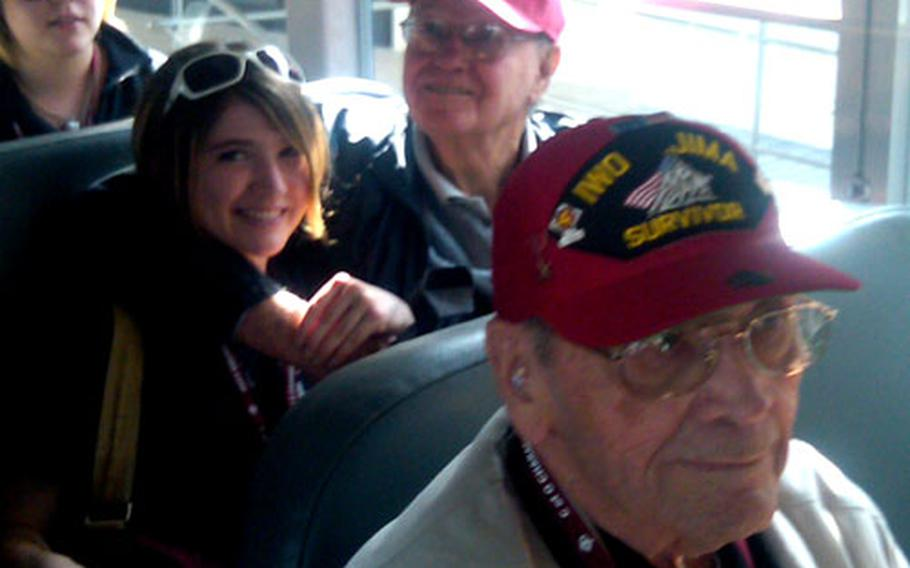 Veterans Max Brown, front, and Don Whipple and a student take the bus to the plane.