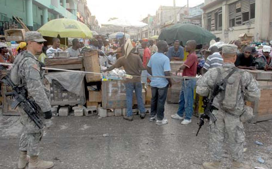 U.S. troops don't wear body armor or helmets but carry loaded weapons during patrols in Port-au-Prince.
