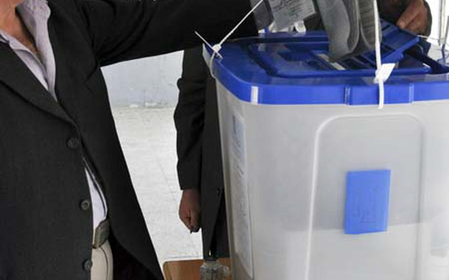 Aziz Mohamed casts his ballot at a polling place on Sadoon Street in eastern Baghdad. Mohamed, a Kurd, said he chose a cross-sectarian alliance over the main Kurdish bloc.