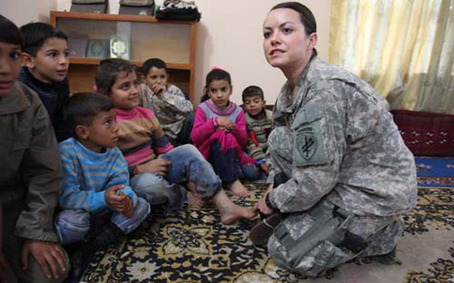 """First Lt. Nicole Siemer, an American civil affairs officer, launched a program to help widows in Najaf register for government assistance programs last summer. Siemer expressed frustration that programs for women were given low priority by the military. """"We're talking about more than half the population,"""" she said."""