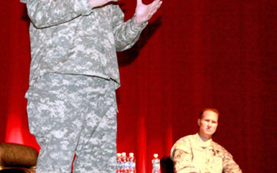 Lt. Gen. Jack Stultz, U.S. Army Reserve commander discusses with soldiers the ongoing changes in the reserves at the Camp Zama community center on Thursday.