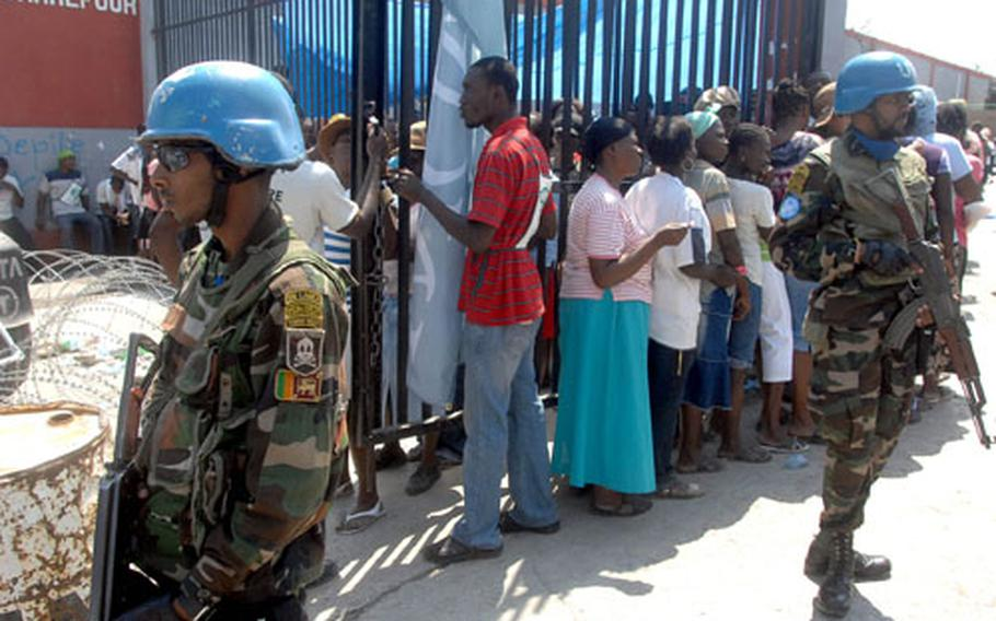 Sri Lankan peacekeepers provided security along with Haitian police at this food distribution point in Carrefour on Wednesday.