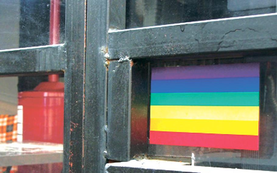 A rainbow sticker hangs in the window of a lounge in Seoul's gay-friendly Homo Hill district, which attracts both gay and straight customers, including U.S. troops.