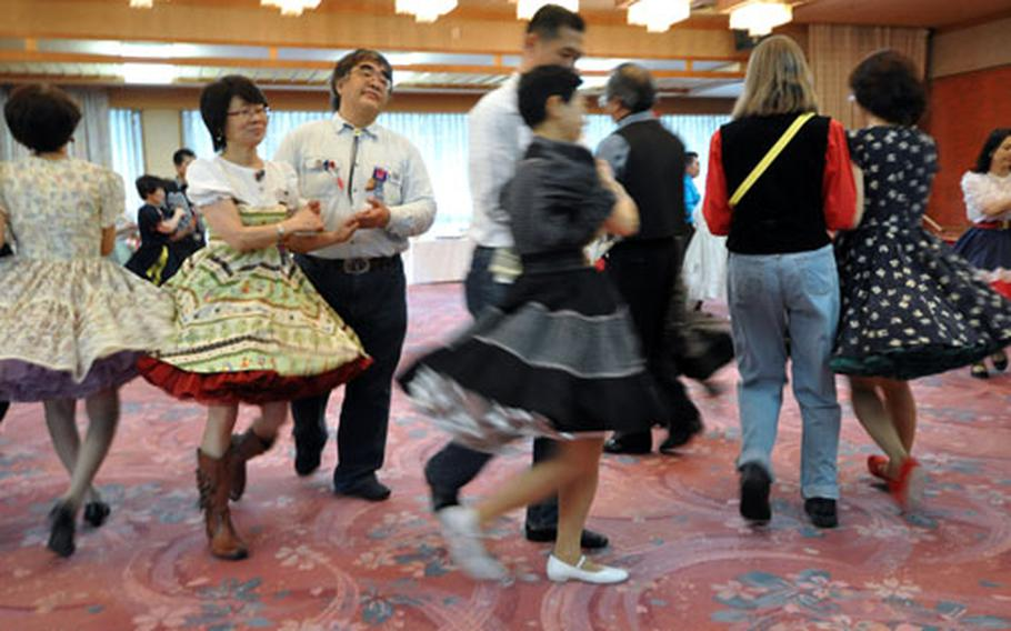 """Square dancers follow the cues of their """"caller"""" during the 49th annual Misawa Torii Twirlers Jamboree on Saturday in Misawa city, Japan."""