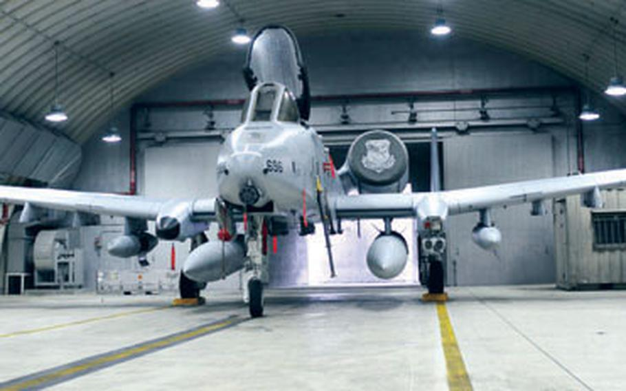 At Osan Air Base in South Korea earlier this month, a newly arrived A-10C ground attack plane assigned to the 25th Fighter Squadron sits in a hanger. The squadron has begun a transition from the A-10A to the newer C-model, which, among other new capabilities, can launch state-of-the-art GPS satellite-guided smart bombs, something the A model could not.