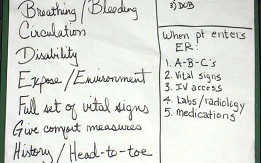 Procedures are outlined on a notepad displayed inside a mobile medical facility set up Tuesday at Camp Stanley.