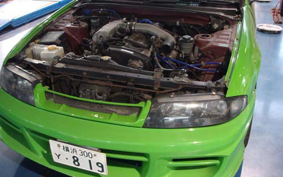 Once a high-performance sports car, this 1993 Nissan Skyline sits without a hood, turbo system and several other stolen engine parts at the Yokosuka Naval Base Autoport. Briggs is moving to the United States in a few days and says he will have to junk the car.