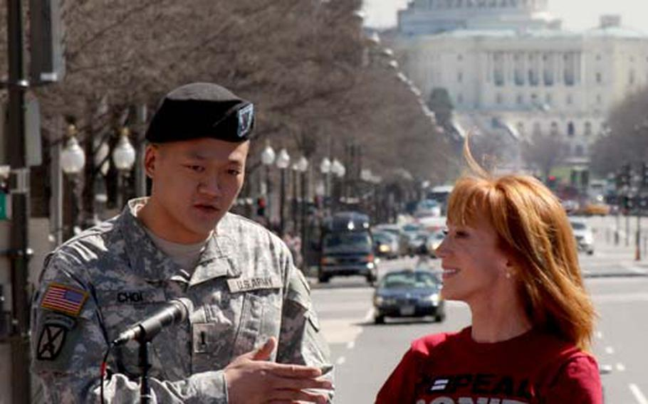 """Comedienne Kathy Griffin and Army 1st Lt. Dan Choi speak at a Washington, D.C. rally Thursday to repeal the military's ban on openly gay servicemembers. New York Army National Guard officials have recommended that Choi be discharged under the """"don't ask, don't tell"""" law."""