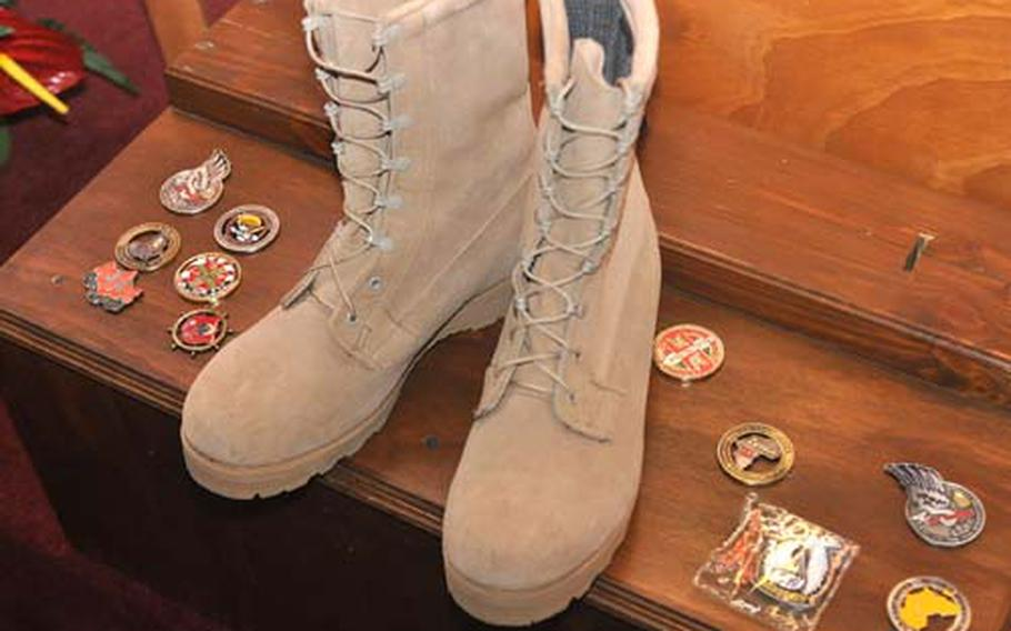 Soldiers from a variety of organizations based at Caserma Ederle in Vicenza, Italy, left commanders coins as a tribute to Pfc. Nicholas Scott Cook, who was killed in Afghanistan on March 7. The community remembered Cook in a memorial service Tuesday.