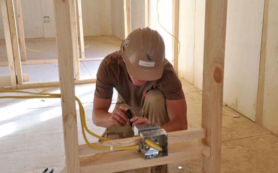 Petty Officer 2nd Class James Pyle, a Navy Seabee, works at the construction site at Forward Operating Base Sharana.