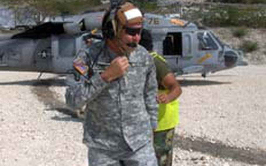 Lt. Gen. Ken Keen, Joint Task Force-Haiti commander, steps off a helicopter in Haiti.