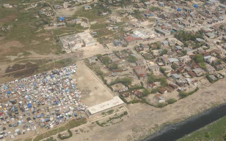 Lt. Gen. Ken Keen looked down from a helicopter circling over earthquake-ravaged Port-au-Prince last Wednesday and saw a patchwork of multicolored tents that had sprouted among the Haitian capital's rusting corrugated iron roofs and collapsed buildings to house hundreds of thousands left homeless by the disaster.