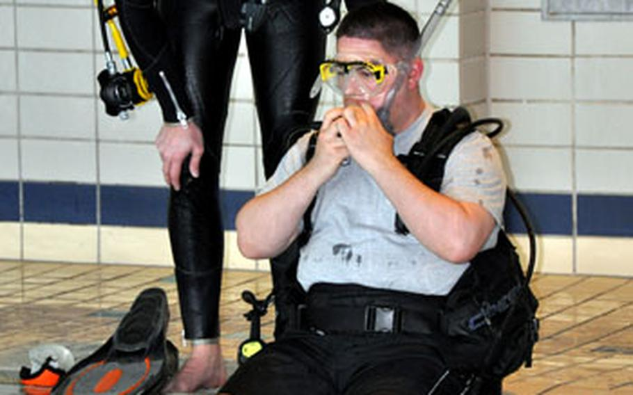 Sgt. Charlie Melendez prepares for his first dive during a scuba class on Sunday.