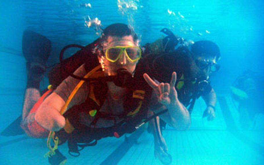 Spc. Jake Altman, who lost part of his right arm while deployed to Iraq, participates in a scuba diving class for wounded warriors.