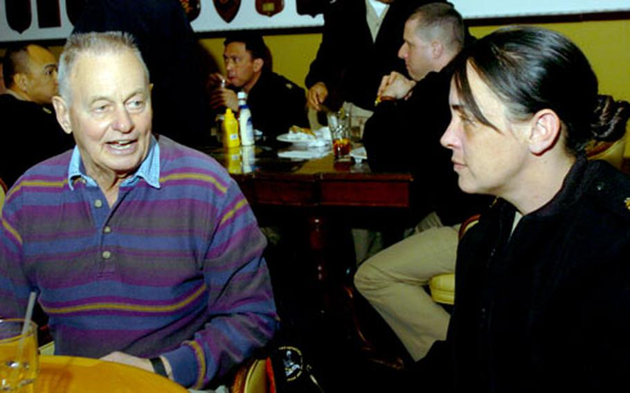 """Rudy Boesch, retired Navy SEAL and contestant from the first season of television's """"Survivor,"""" talks with sailors at Chief Petty Officer's club at Yokosuka Naval Base on Tuesday. Boesch's Navy career spanned 45 years, from the end of World War II to the beginning of Desert Storm."""