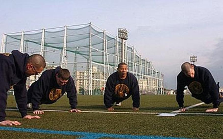Sailors from the Naval Computer and Telecommunications Station Far East work out Friday during command physical training at Yokosuka Naval Base. The Navy is considering changes to its annual physical readiness test, the director of the service's Physical Readiness Program said last week.
