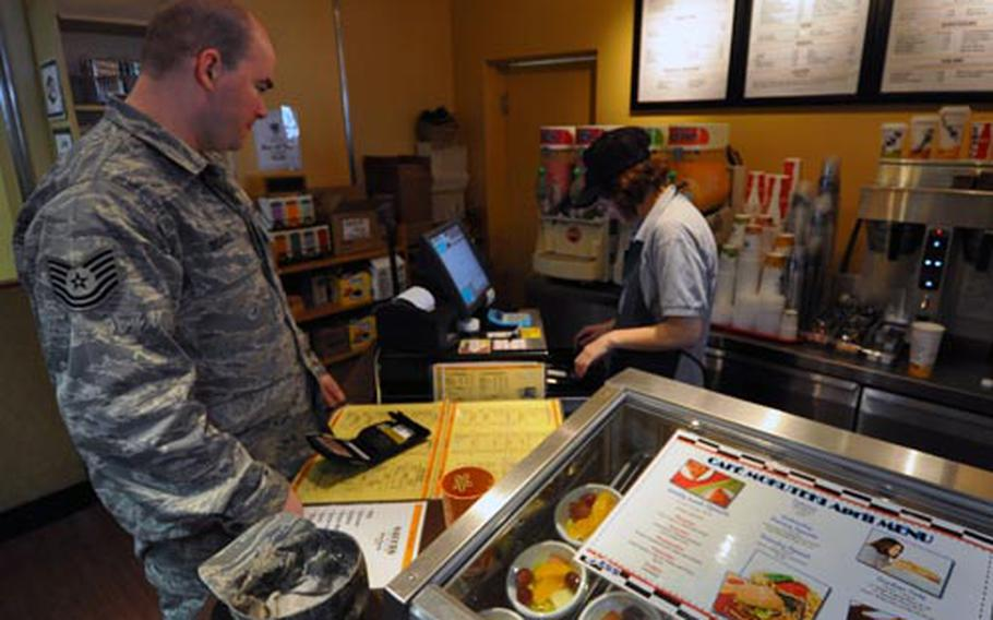"""Tech. Sgt. Daniel Beasely orders a drink at the Mokuteki Cafe Friday at Misawa Air Base, Japan. He said a new initiative to offer and better promote healthful eating options on the base would be welcomed since they will """"promote a healthier lifestyle."""""""