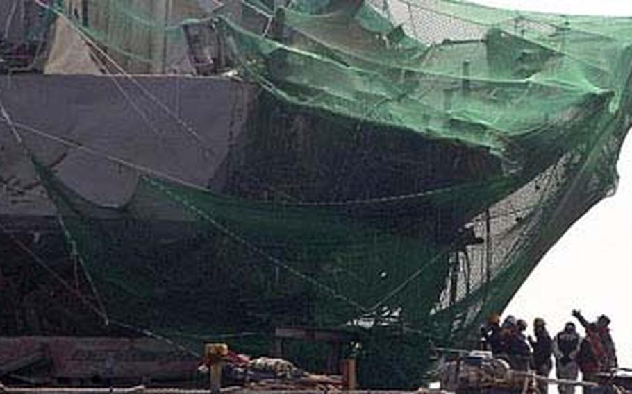 Sunken South Korean naval ship Cheonan on the barge, is salvaged off Baengnyeong Island, South Korea.