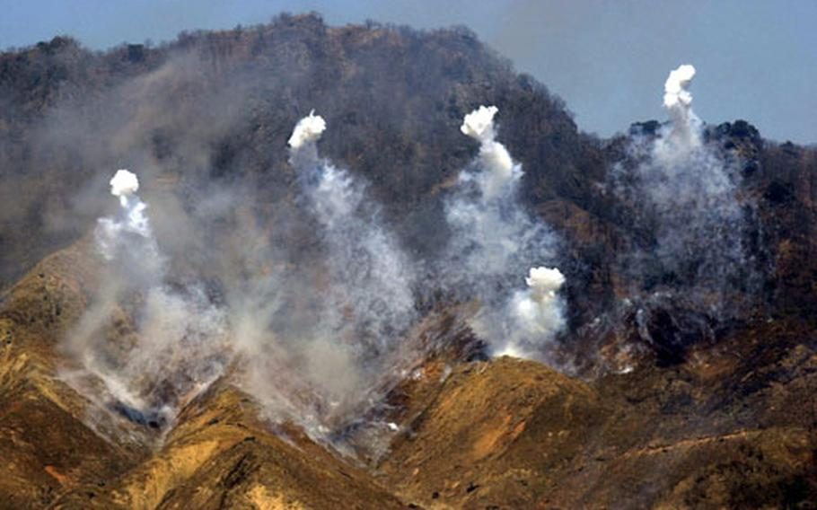 Smoke rises from explosions as targets on a hillside are fired upon during a live-fire training exercise Thursday at Rodriguez Range in South Korea.