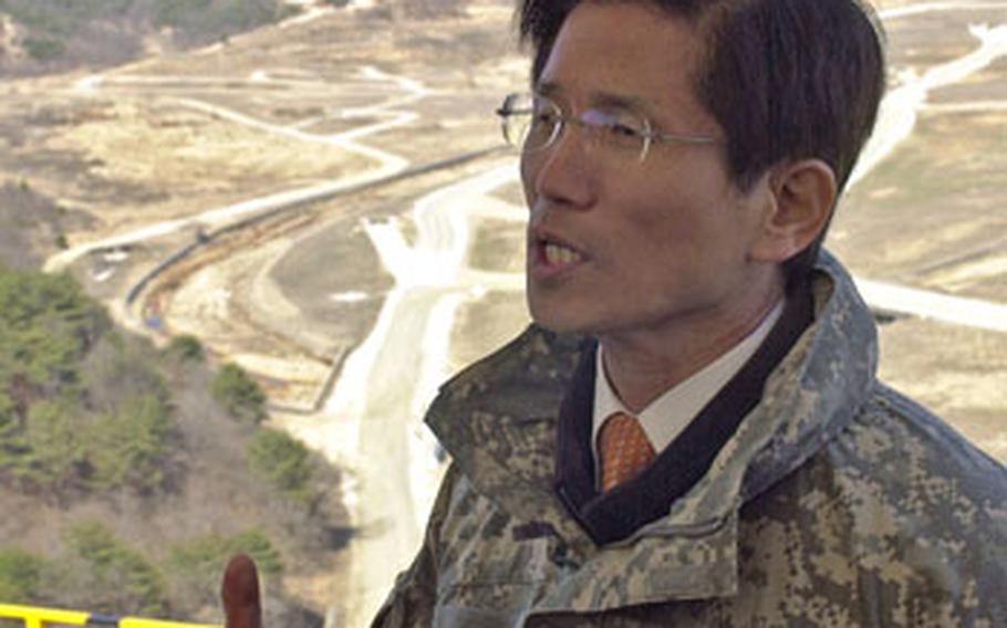 """As smoke rises from a hillside after the exercise, Gyeonggi Gov. Kim Moon-soo tells media members, """"The Korean people should feel assured that the strong alliance between the U.S. and South Korea will keep South Korea safe."""""""