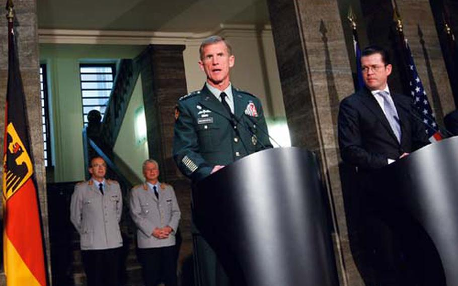 Top U.S. and NATO commander General Stanley A. McChrystal, left, and German Defense Minister Karl-Theodor zu Guttenberg, right, brief the media after their talks at the Defense Ministry in Berlin, Germany, Wednesday, April 21, 2010.
