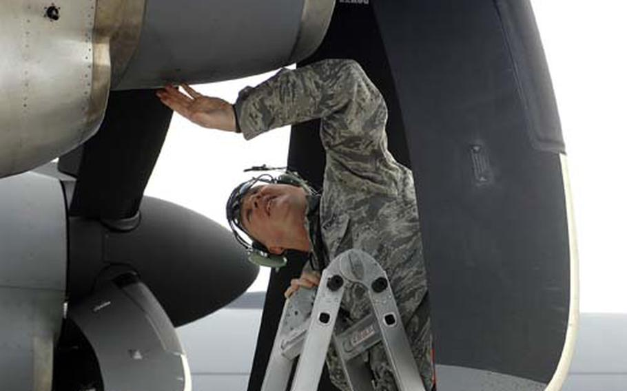 Master Sgt. Darren Veneman of the 86th Aircraft Maintenance Squadron at Ramstein Air Base, Germany, checks the engine of a C-130J, after a test flight on Wednesday. The visual inspection of the plane showed no damage from volcanic ash, and the squadron was analyzing the computer data from the flight.