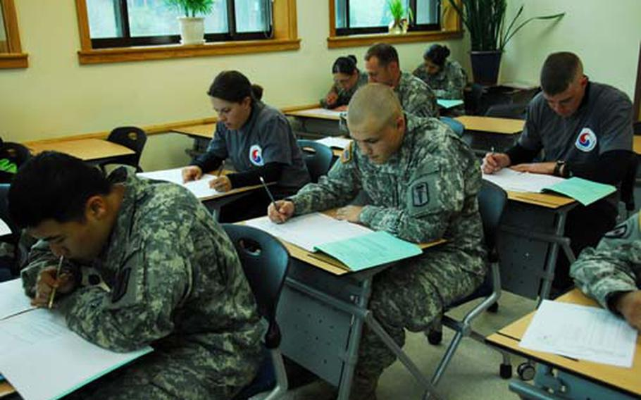 Members of HHC 65th Medical Brigade take their driver's license tests at U.S. Army Garrison-Yongsan, South Korea, on Thursday. Rules for maintaining licenses vary by command and can be complex.