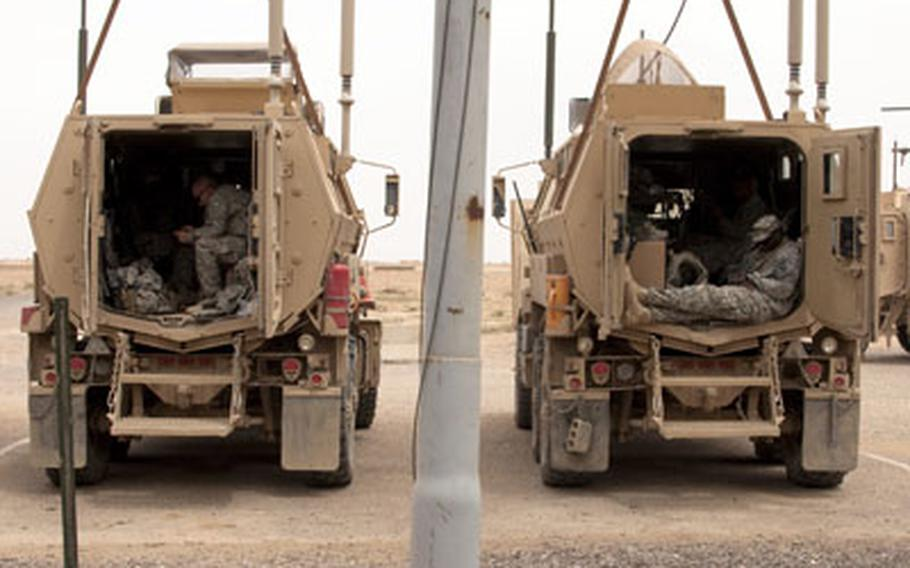 U.S. soldiers relax inside their MRAPs before leaving Forward Operating Base Summerall for good. The sprawling base near Baiji, Iraq, was handed over to the Iraqi government on April 17.