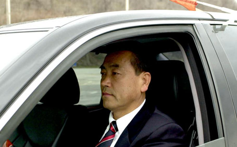 """Kwak Sang-bae, president of Chung Song Trade Co., a women's clothing manufacturer, drives to join a caravan of vehicles headed from South Korea to the Kaesong Industrial Complex in North Korea. Kwak said he is worried he and his company could get caught in the middle if hostilities resumed between the two Koreas, """"but, as a businessman, I am trying to do my best under the circumstances."""""""