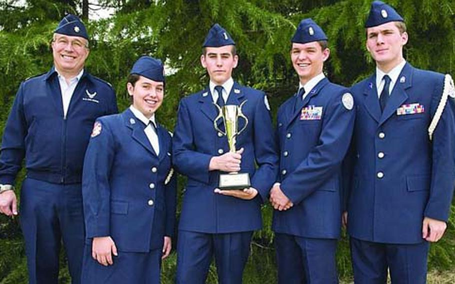 The JRTOC team from Edgren High School on Misawa Air Base, Japan, shows off its trophy after winning the 2010 Air Force JROTC Academic Bowl in Washington, D.C., on April 24. From left are retired Lt. Col. Ted M. Ball, Edgren's JROTC director; Monica Cronin; Bryan Bancroft; Scott Cronin; and Michael Warden.
