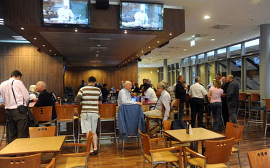 The bar area of the new Wiesbaden Entertainment Center includes stools, table seating and large televisions.