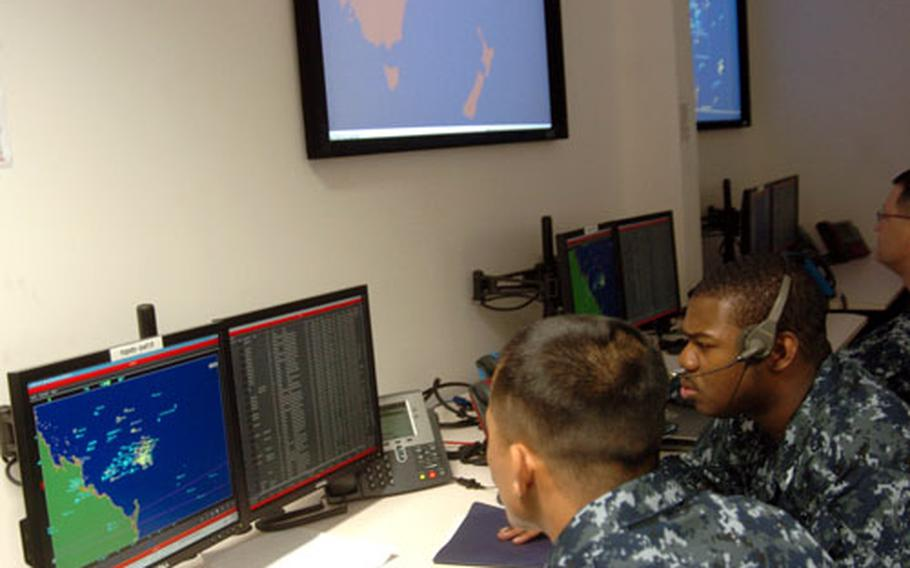 Sailors from the USS Cowpens react to incoming data during Operation Coral Dagger, a four-day bilateral exercise with the Australian Navy that served as the grand opening of a new battle lab at Yokosuka Naval Base on Monday.