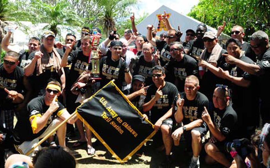 The Torii Knights celebrate after winning their heat in their race against two Okinawa teams at the 36th Naha Hari dragon boat races at Naha, Okinawa Wednesday. They set a blistering time of 5 minutes and 53 seconds. Japanese and U.S. military teams competed in heats of three boats, all brightly painted and resembling mythical sea dragons.
