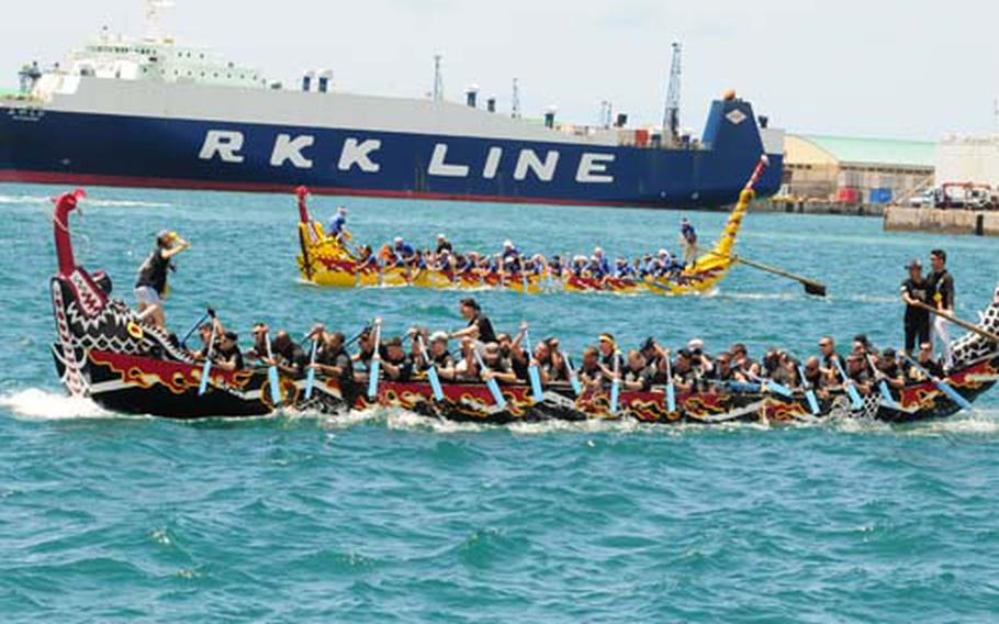 The Torii Knights race against a Japanese team to the finish line during the 36th Naha Hari dragon boat races at Naha, Okinawa Wednesday.