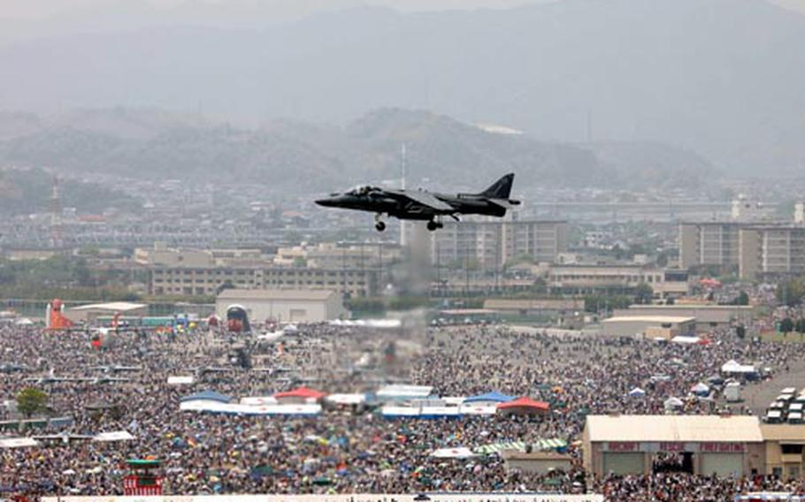 An AV-8B Harrier demonstrates its vertical/short takeoff and landing maneuvers in front of thousands of spectators during the annual Friendship Day air show at Marine Corps Air Station Iwakuni.