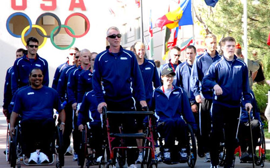 The 25 wounded airmen representing the Air Force in the inaugural Warrior Games in Colorado Springs, Colo., are introduced during the opening ceremony Monday night. About 200 athletes, who have physical and mental injuries and are competing on behalf of their services, will face off in events such as sitting volleyball, archery, shooting and wheelchair basketball.