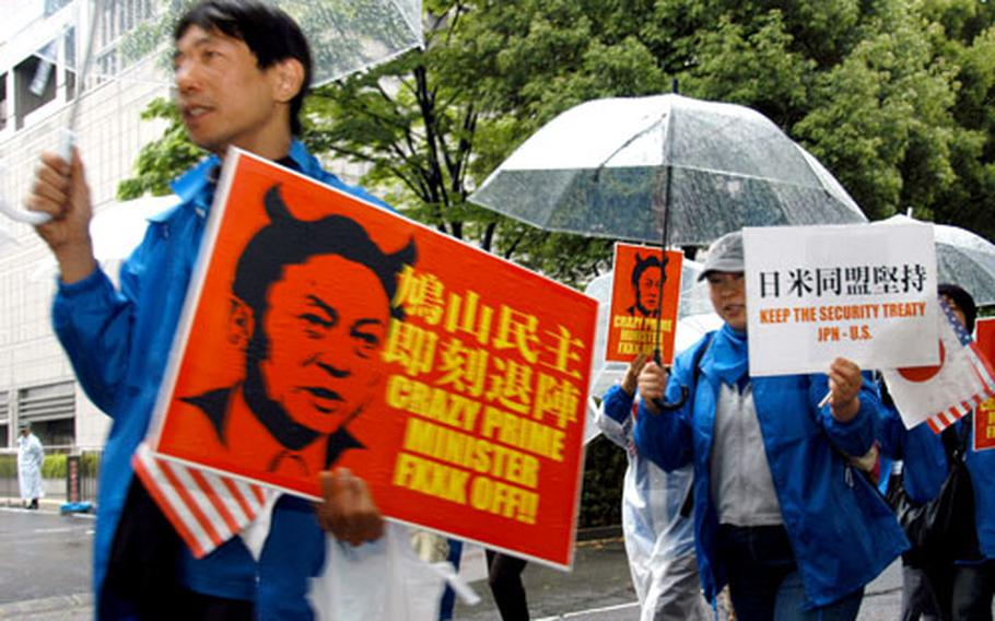 Protesters march in Tokyo on Tuesday, calling for a stronger U.S.-Japan alliance and Japanese government commitment to the 2006 agreement to close Marine Corps Air Station Futenma and move it to a new facility to be built at Camp Schwab.