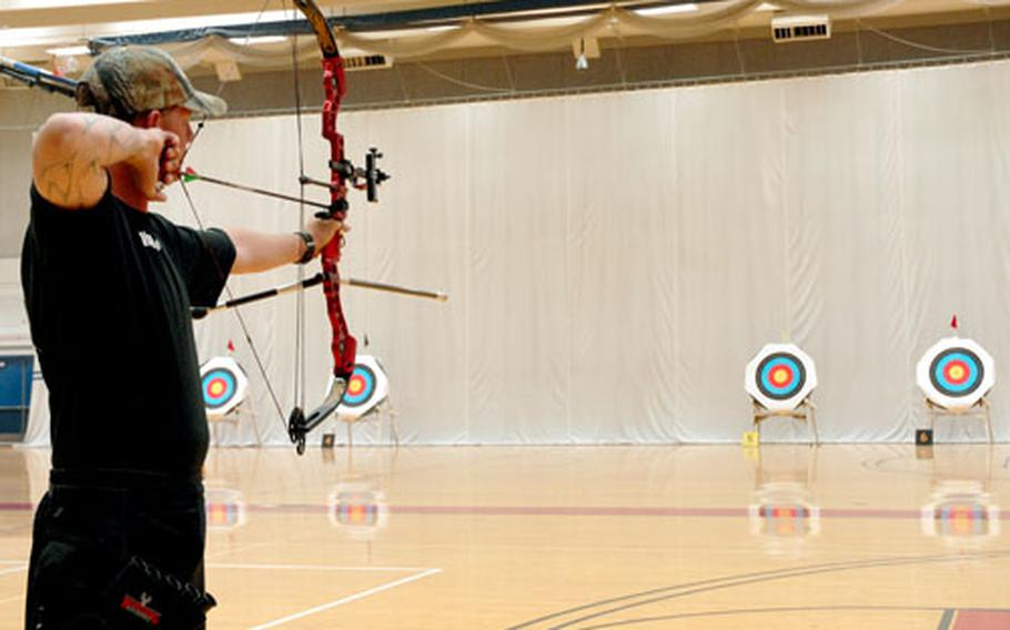 Spc. Travis Akin, who has TBI and PTSD, competes for bronze Tuesday in the archery competition of the inaugural Warrior Games for wounded service members at the Olympic Training Complex in Colorado Springs, Colo. He lost out on the medal to fellow soldier Sgt. Robert Price.