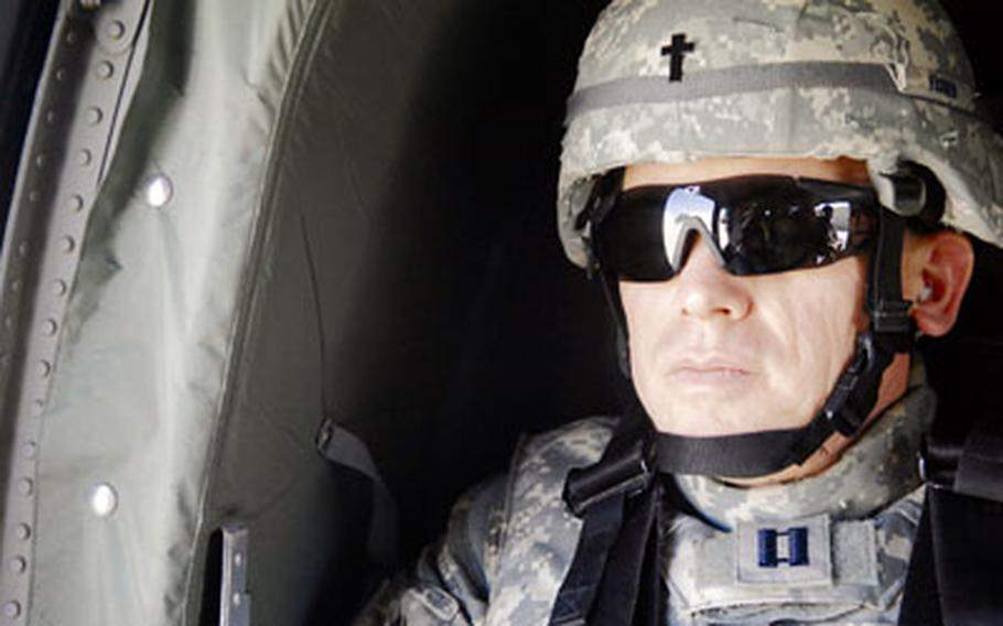 Chaplain (Capt.) Steve Fisher sits aboard a UH-60 Black Hawk en route to Baghdad in March. Fisher, the 732nd Expeditionary Group chaplain, visited more than 100 airmen in remote locations in Iraq.