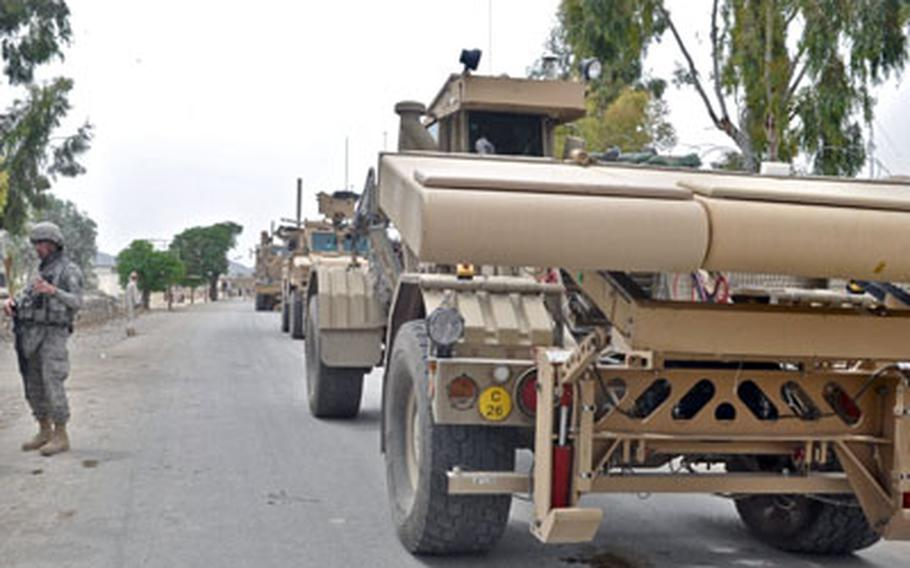The Husky vehicle, with its ground-penetrating radar, patrols the village of Yaqubi in the Sabari district of Khost province along the bomb-riddled Route Alaska on April 7.