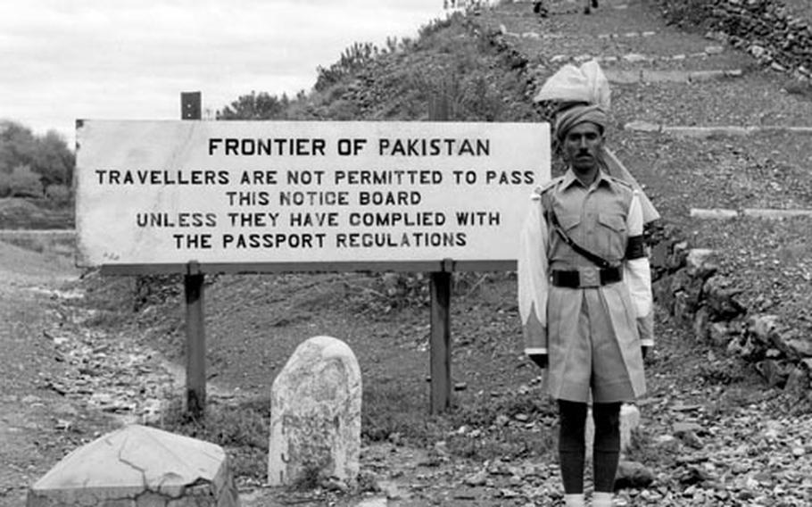 A militiaman from the Khyber Rifles stands guard at the Khyber Pass in 1958.