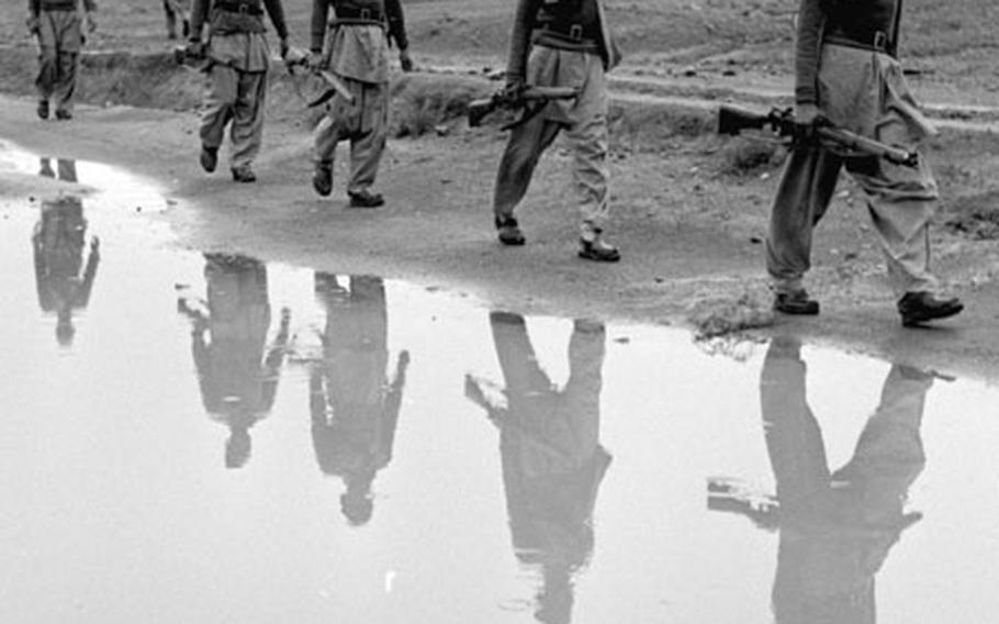 A Khyber Rifles patrol moves out along the frontier.