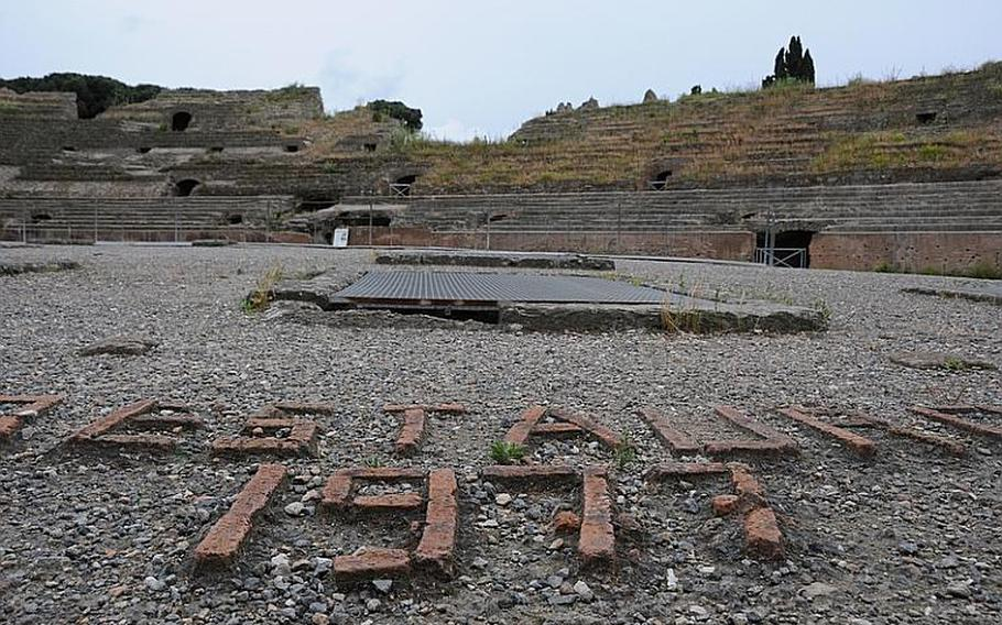 Bricks form the numeral 1977, the year that the last major restoration was done to the Flavio amphitheater in Pozzuoli, Italy. The amphitheater is the third largest surviving theater of the Roman empire.