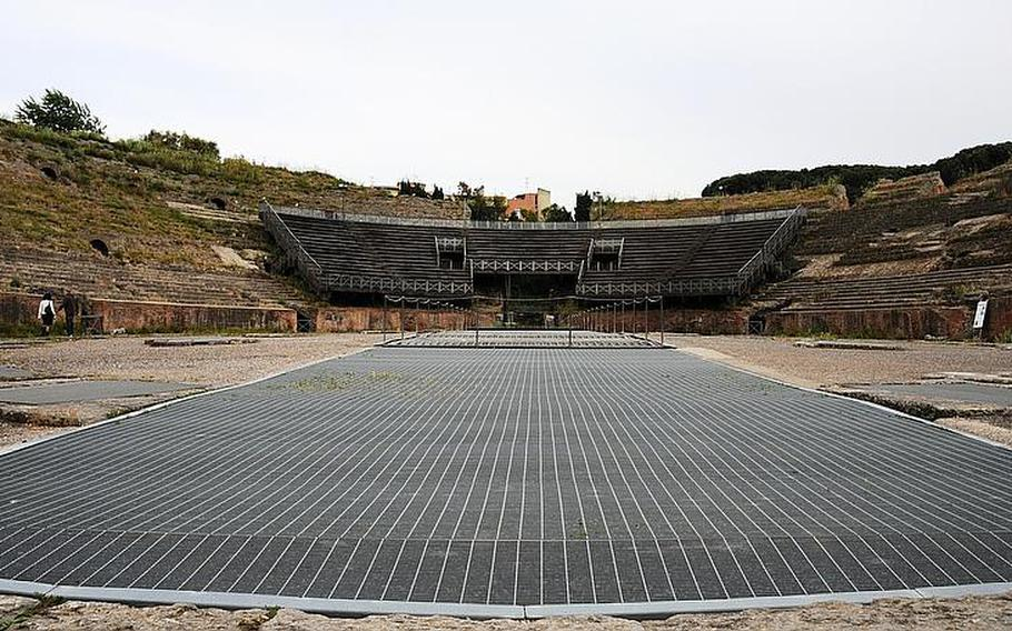 The vast center arena of the Flavio amphitheater in Pozzuoli, Italy, is where gladiators met their fate, often against exotic animals such as tigers and lions. The gladiators fought to the end - they were either mauled to death, or managed to slay their adversaries. The metal grates cover a large channel in the middle of the arena through which decorative scenes were raised from the underground cells.