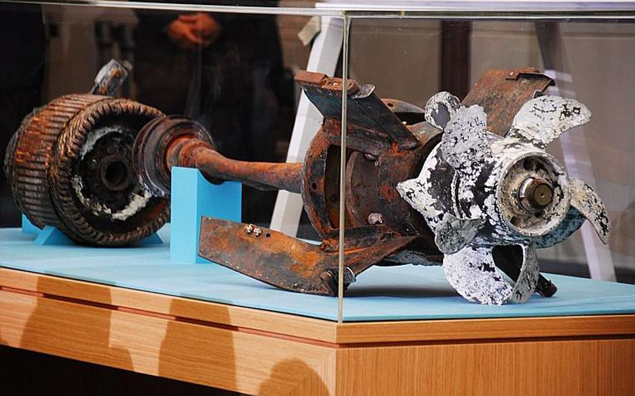 220510WARSHIPWEBphoto01 Ashley Rowland/Stars and Stripes May 20, 2010 Investigators say this is the propeller and motor of the torpedo that investigators say caused the sinking of a South Korean ship on March 26, killing 46 troops. The investigation team exhibited the parts Thursday during a press conference at the Ministry of National Defense when it announced its findings in the sinking of the Cheonan. The team concluded that a North Korean submarine shot the torpedo, which caused a shock wave bubble that ripped the ship in half.